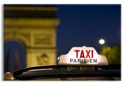 The Arc de Triomphe in Paris with Taxi