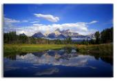 The Teton Range reflecting in the Snake River